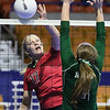 (Brad Davis/The Register-Herald) PikeView's Laken McKinney taps the ball over as Winfield's Emily Reed defends during the Panthers' opening round win in the class AA State Volleyball Tournament Friday morning at the Charleston Civic Center.