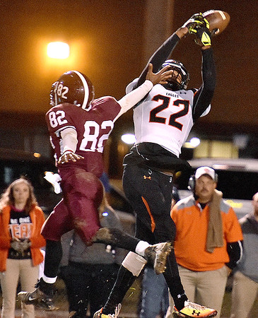 (Brad Davis/The Register-Herald) Woodrow Wilson's Avante Burnett is out-jumped by South Charleston's Lawrence Bryson on a deep pass play Friday night at Van Meter Stadium.