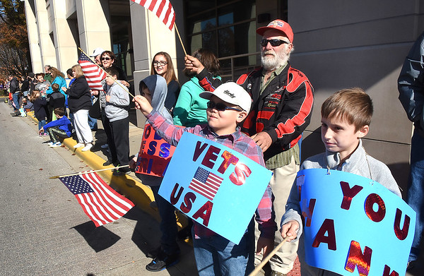Spectators waving American flags during the Beckley Veterans Day Parade Friday morning.<br /> (Rick Barbero/