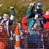(Brad Davis/The Register-Herald) Eager youngsters spot and wave at the approaching helicopter in the sky carrying Santa Claus to his opening day appearance at the Crossroads Mall Saturday afternoon.