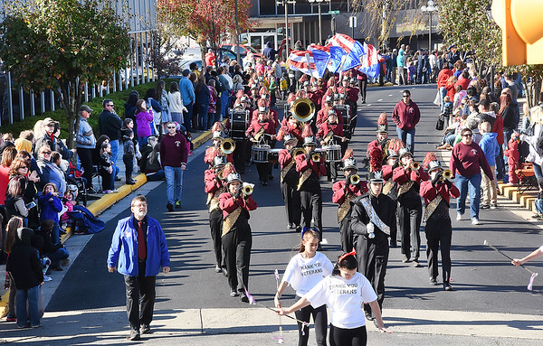 Woodrow Wilson High School marching band marching up Neville Street inMarshal, waves to a large crowd on Neville Street.<br /> (Rick Barbero/The Register-Herald)