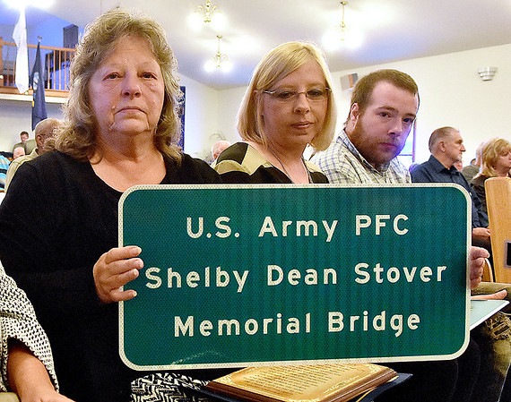 (Brad Davis/The Register-Herald) From left, Shirley Stover-Estep, twin sister of the late Shelby Dean Stover, poses for a quick photo with her children (Shelby's grandchildren) Jeannie and Leroy Pettry following special Veteran's Service at Ewing Creek Church Sunday afternoon in Clear Creek. The service honored veterans in attendance and a bridge along Rt. 1 was dedicated in honor Stover, who was killed during the Vietnam War.