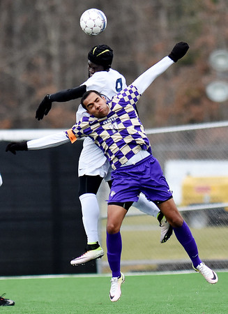 WVU Tech's Prince Idornigie (9) challenges for the ball against Olivet Nazarene's Matheus Guimaraes (11) during the first half of their match at the YMCA Soccer Complex in Beckley. (Chris Jackson/The Register-Herald)