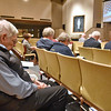 (Brad Davis/The Register-Herald) Attendees bow their heads in prayer during the Greater Beckley Area Ministerial Association's Service of Prayer and Unity Tuesday night at United Methodist Temple.