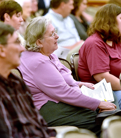 (Brad Davis/The Register-Herald) State employees listen carefully as specifics about new premiums and coverage are read during Thursday night's PEIA public hearing at Tamarack.