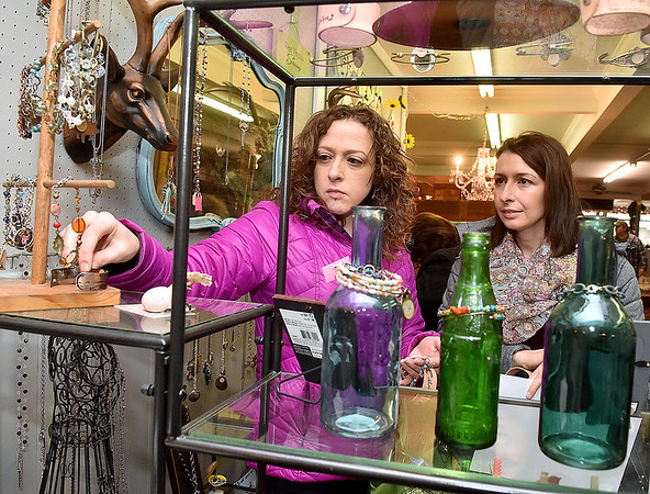 (Brad Davis/The Register-Herald) Sisters Jenni Canterbury, right, and Brandi Radford check out the various items inside Tickety Boo during the first ever Small Business Saturday shopping event yesterday in Uptown Beckley.