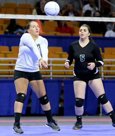 (Brad Davis/The Register-Herald) Fayetteville's Faith Norris returns the ball during the Pirates' opening round game against Williamstown in the class A State Volleyball Tournament Friday morning at the Charleston Civic Center.