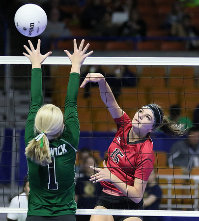 (Brad Davis/The Register-Herald) PikeView's Mackenzie Bridges hits the ball as Winfield's Autumn Elswick defends during the Panthers' opening round win in the class AA State Volleyball Tournament Friday morning at the Charleston Civic Center.