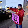 "(Brad Davis/The Register-Herald) Church member Cathy Abernathy and a handful of other demonstrators wave at passing motorists as they ""Stand on the Side of Love"" along Neville Street in front of Jim Word Memorial Park Thursday night. Stressing that it was not a protest, members of Beckley's New River Unitarian Universalist Fellowship, located at 911 South Kanawha Street, got out to encourage people to relax and have a little love for another following an intense election season."