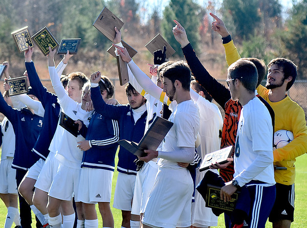 (Brad Davis/The Register-Herald) East Fairmont players salute their fans and family in the stands as they celebrate with the trophy after claiming the Class A/AA Boys State Championship Saturday morning at the YMCA Paul Cline Memorial Sports Complex.