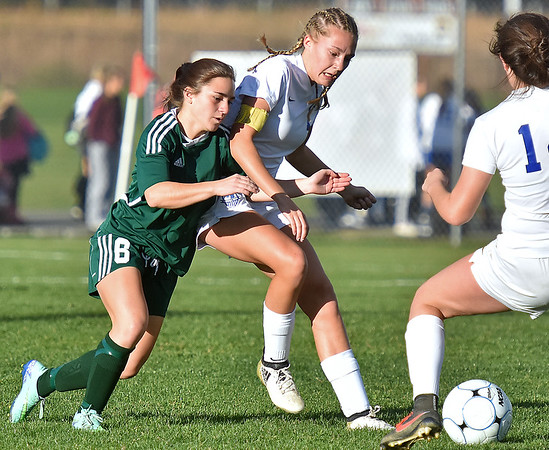 (Brad Davis/The Register-Herald) Fairmont Senior's Sophie Manchin battles for possession with Winfield's Abigail Dye Friday evening at the YMCA Paul Cline Memorial Soccer Complex.