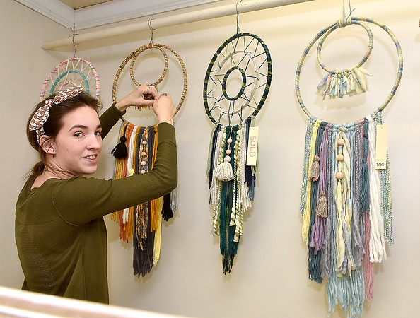 (Brad Davis/The Register-Herald) Artist Jamie Gonzalez, owner of Indio Yarn Art, during Small Business Saturday shopping event yesterday in Uptown Beckley.