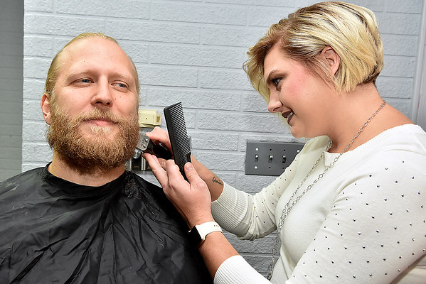 (Brad Davis/The Register-Herald) Beckley resident Matt Gilson takes the opportunity for a beard trim from Kiltded Barber stylist Kayla Pysz inside the Kirkpatrick building during the first ever Small Business Saturday shopping event yesterday in Uptown Beckley.