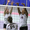 (Brad Davis/The Register-Herald) Woodrow Wilson's Sydney McClung, left, and Makayla Walton leap to try and block a hit from Musselman's Sarah Wright during the Flying Eagles' second round loss to the Applemen in the class AAA State Volleyball Tournament Friday night at the Charleston Civic Center.