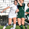 (Brad Davis/The Register-Herald) Fairmont Senior's Hannah Floyd battles for possession with Winfield's Camille Frye Friday evening at the YMCA Paul Cline Memorial Soccer Complex.