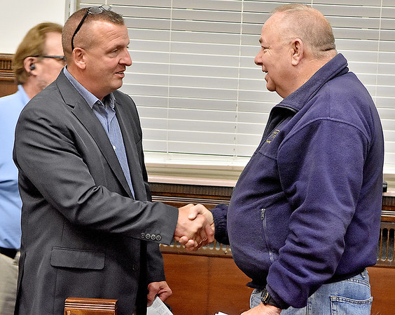 (Brad Davis/The Register-Herald) Raleigh County Sheriff candidate Scott Van Meter, left, is congratulated by opponent Stan Ellison after being called the winner Tuesday night at the Raleigh County Courthouse.