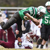 Fayetteville's Marcus Lively is tackled by Wheeling Central's (70) during their Class A quarterfinal game Saturday in Fayetteville. (Chris Jackson/The Register-Herald)