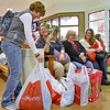 (Brad Davis/The Register-Herald) Beckley native and North Carolina resident Heather Campbell, left, sets down her shopping bags for a moment as she shares a few laughs with friends (from left of Campbell) Donna Flanagan, Nancy Tuckwiller and Christy Armstrong while taking a break from a day full of Black Friday deal hunting Friday evening inside the Crossroads Mall.