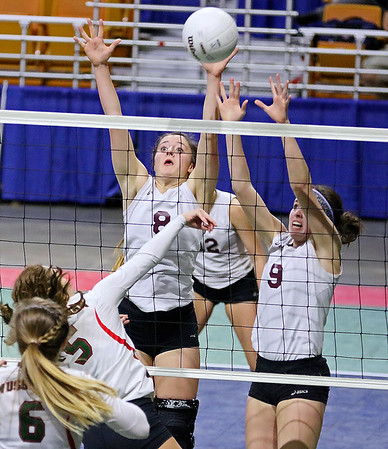 (Brad Davis/The Register-Herald) Woodrow Wilson's Adrian Coalson, left, and Sydney McClung scramble to block a hit from Musselman's Kailea Petry during the Flying Eagles' second round loss to the Applemen in the class AAA State Volleyball Tournament Friday night at the Charleston Civic Center.