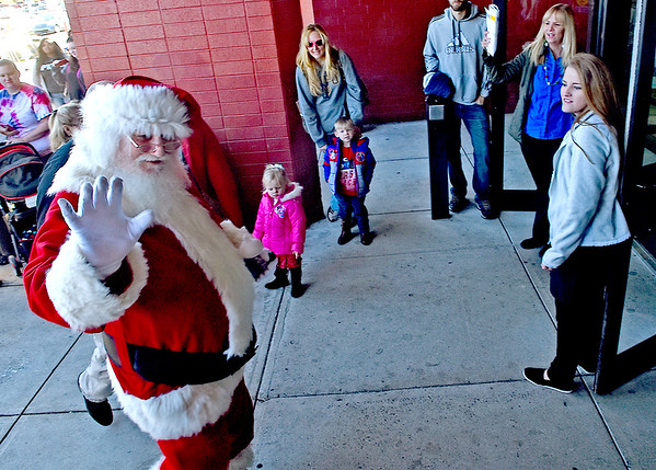 (Brad Davis/The Register-Herald) Santa Claus makes his way inside on his opening day arrival at the Crossroads Mall Saturday afternoon.