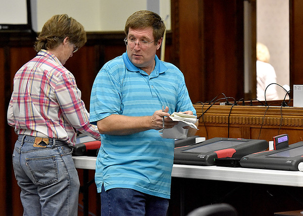 (Brad Davis/The Register-Herald) Election workers tabulate results from incoming precincts at the Raleigh County Courthouse Tuesday night.