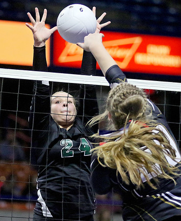(Brad Davis/The Register-Herald) Fayetteville's Kendall Malay leps to block a hit from Williamstown's Bethany Arnold during the Pirates' opening round game in the class A State Volleyball Tournament Friday morning at the Charleston Civic Center.