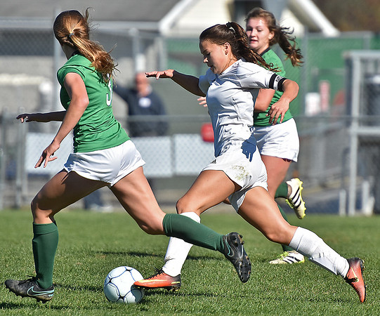 (Brad Davis/The Register-Herald) Winfield's Sydney Cavender speeds past Charleston Catholic's Anna Hewitt during the Generals' State Championship win Saturday at the YMCA Paul Cline Memorial Sports Complex.