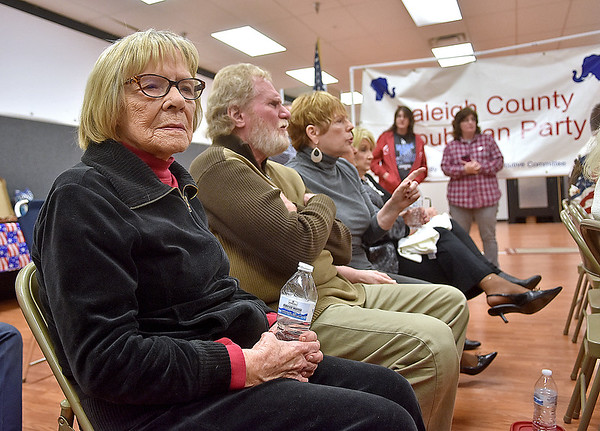 (Brad Davis/The Register-Herald) Republican supporters look on as election results start to come in during a watch party at Raleigh County GOP Headquarters Tuesday night in the Cranberry Creek Shopping Center.