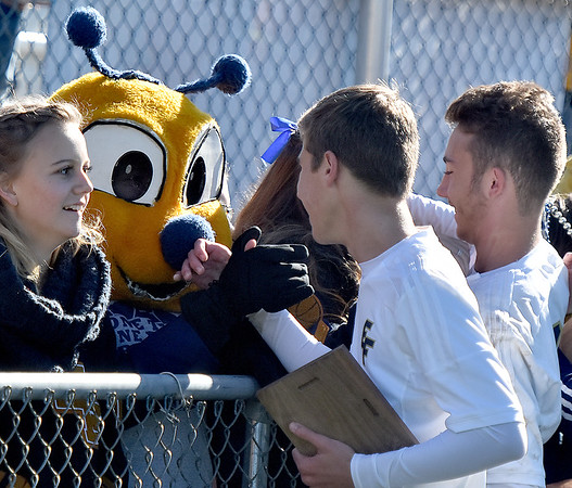 (Brad Davis/The Register-Herald) East Fairmont players get some kudos from the school mascot as they celebrate with the trophy after claiming the Class A/AA Boys State Championship Saturday morning at the YMCA Paul Cline Memorial Sports Complex.