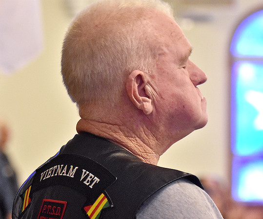 (Brad Davis/The Register-Herald) Vietnam veteran and Beckley resident David Williams reflects breifly as he and other veterans in attendance stand to be recognized during a special Veterans Service and bridge dedication for late U.S. Army PFC Shelby Dean Stover Sunday afternoon at Ewing Creek Church in Clear Creek.