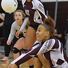 (Brad Davis/The Register-Herald) Woodrow Wilson's Makayla Walton returns the ball during the Flying Eagles' win over the Red Dragons Saturday night in Beckley.