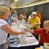 (Brad Davis/The Register-Herald) Attendees shop at Rada Cutlery's booth, one of several vendors on hand during the annual Taste of Home Cooking School Thursday night at the Beckley-Raleigh County Convention Center.