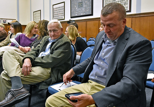(Brad Davis/The Register-Herald) Raleigh County Sheriff candidate Scott Van Meter, right, keeps a close eye on incoming results as his dad John sits with him at left Tuesday night at the Raleigh County Courthouse.