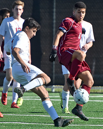 (Brad Davis/The Register-Herald) University's Joseph Biafora winds up for a strike as George Washington's Ahmed Mohamed steps up to block it during the Class AAA boys State Championship Saturday at the YMCA Paul Cline Memorial Sports Complex.