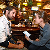 (Brad Davis/The Register-Herald) Barcelona, Spain natives Quim Vives, left, and Caterina Barjau spend some time experiencing the U.S. General Election from a small town perspective at Foster's Main Street Tavern Tuesday night.