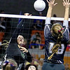 (Brad Davis/The Register-Herald) Fayetteville's Caroline Fenton hits the ball as Williamstown's Nellie King defends during the Pirates' opening round game in the class A State Volleyball Tournament Friday morning at the Charleston Civic Center.