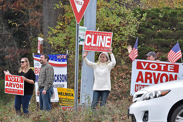 (Brad Davis/The Register-Herald) Republican 9th District State Senate candidate Sue Kline, second from right, joins other GOP supporters in waving at motorists as they rally at the intersection of Route 3 and Dry Hill Road Tuesday afternoon.