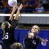 (Brad Davis/The Register-Herald) James Monroe's Whitney Hunt hits the ball as Chapmanville's Carley Cook defends during the Mavericks' opening round win in the class AA State Volleyball Tournament Friday morning at the Charleston Civic Center.