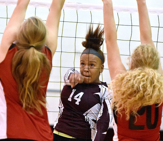 (Brad Davis/The Register-Herald) Woodrow Wilson's Makayla Walton hits the ball across during the Flying Eagles' win over the Red Dragons Saturday night in Beckley.