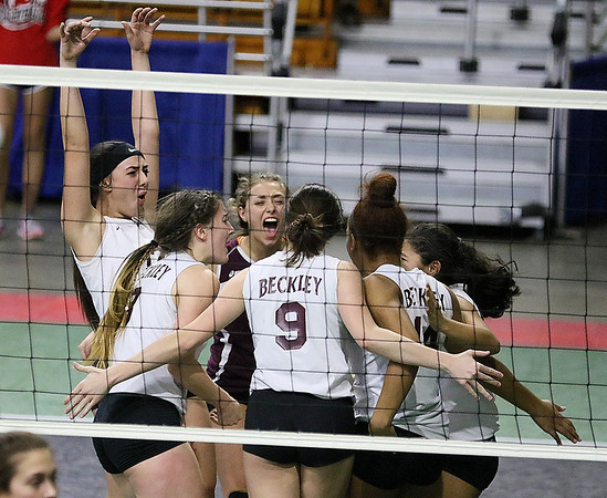 (Brad Davis/The Register-Herald) Woodrow Wilson players gather to celebrate a point scored during the Flying Eagles' second round loss to the Applemen in the class AAA State Volleyball Tournament Friday night at the Charleston Civic Center.