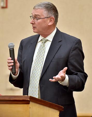 (Brad Davis/The Register-Herald) Ted Cheatham speaks during Thursday night's public hearing on PEIA insurance rates at Tamarack.