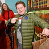 (Brad Davis/The Register-Herald) Ten-year-old Beckley resident Aiden Filipek wants you to know he supports the first ever Small Business Saturday shopping event as he notices the camera and points out his sticker after buying a few things from artist Melanie Hicks, left, yesterday morning in Uptown Beckley.