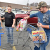 (Brad Davis/The Register-Herald) Oceana residents James and Tina Paynter unload remaining items from their buggy after a round of Black Friday deal hunting at Walmart in MacArthur Friday morning.