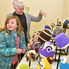 (Brad Davis/The Register-Herald) Eight-year-old Cailyn Humphrey checks out handmade hats during Small Business Saturday shopping event yesterday in Uptown Beckley.