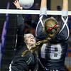 (Brad Davis/The Register-Herald) Fayetteville's Katie Skaggs hits the ball as Williamstown's Nellie King defends during the Pirates' opening round game in the class A State Volleyball Tournament Friday morning at the Charleston Civic Center.