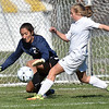 (Brad Davis/The Register-Herald) Winfield's Peyton Frohnapfel tries to get to a loose ball before Charleston Catholic goalkeep Vida Imani can smother it during the Generals' State Championship win Saturday at the YMCA Paul Cline Memorial Sports Complex.