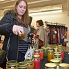 (Brad Davis/The Register-Herald) Beckley resident Jessica Morris looks over item at the Lake House Candles booth inside the Grant building during the first ever Small Business Saturday shopping event yesterday in Uptown Beckley.