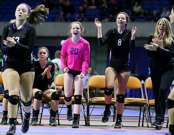 (Brad Davis/The Register-Herald) James Monroe players react to events on the court during the Mavericks' opening round win in the class AA State Volleyball Tournament Friday morning at the Charleston Civic Center.