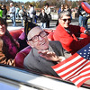 Jack Klaus, WW II Veteran, was the Beckley Veterans Day Parade Marshal, waves to a large crowd on Neville Street.<br /> (Rick Barbero/The Register-Herald)