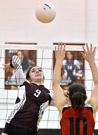 (Brad Davis/The Register-Herald) Woodrow Wilson's Sydney McClung winds up for a kill during the Flying Eagles' win over the Red Dragons Saturday night in Beckley.